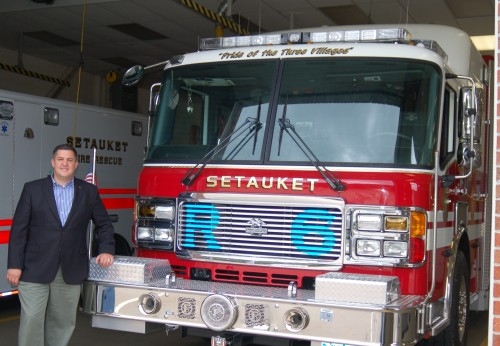Daniel P. Losquadro, Superintendent of Highways for Town of Brookhaven, stands beside one of the more than 500 fire trucks and ambulances upgraded with Opticom™ GPS. (Photo credit: Town of Brookhaven, NY)